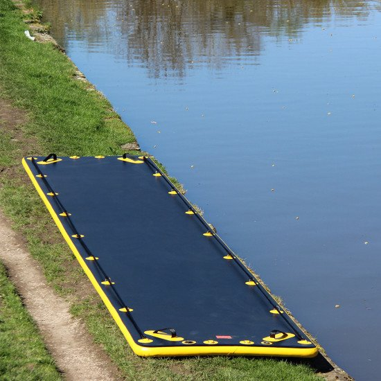 Northern Diver's SRE 8m Inflatable Air Track, alongside the water