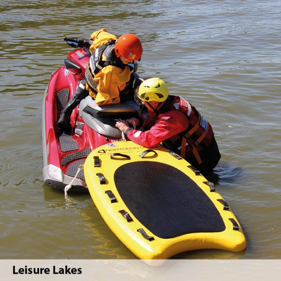 A lifeboard demo day at Leisure Lakes with users wearing our storm water rescue surface suits
